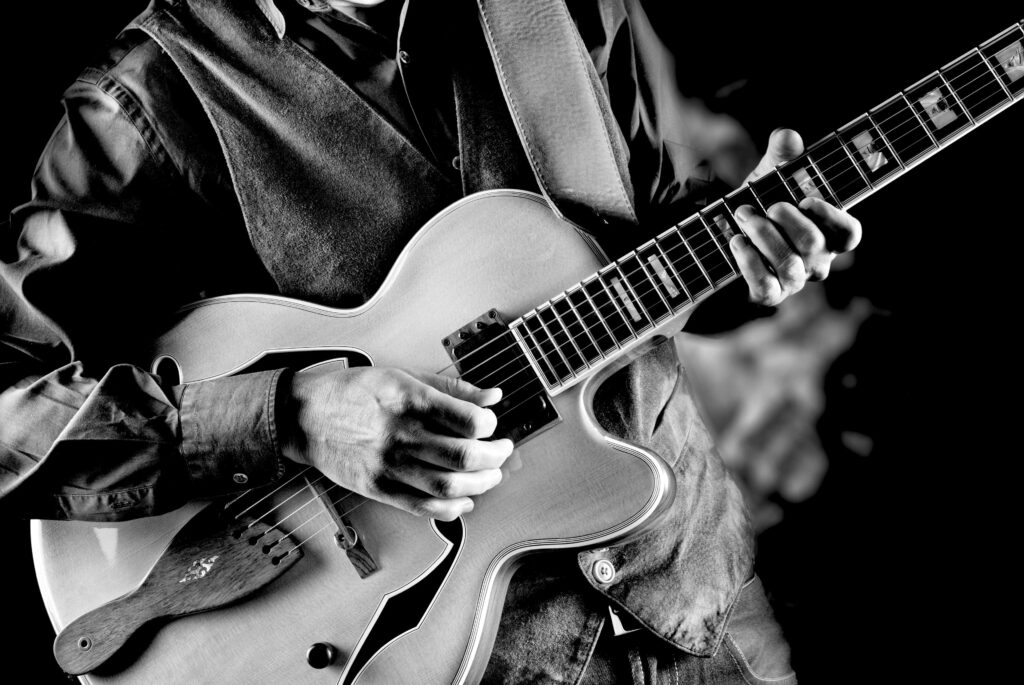 Black and white photo guitar player