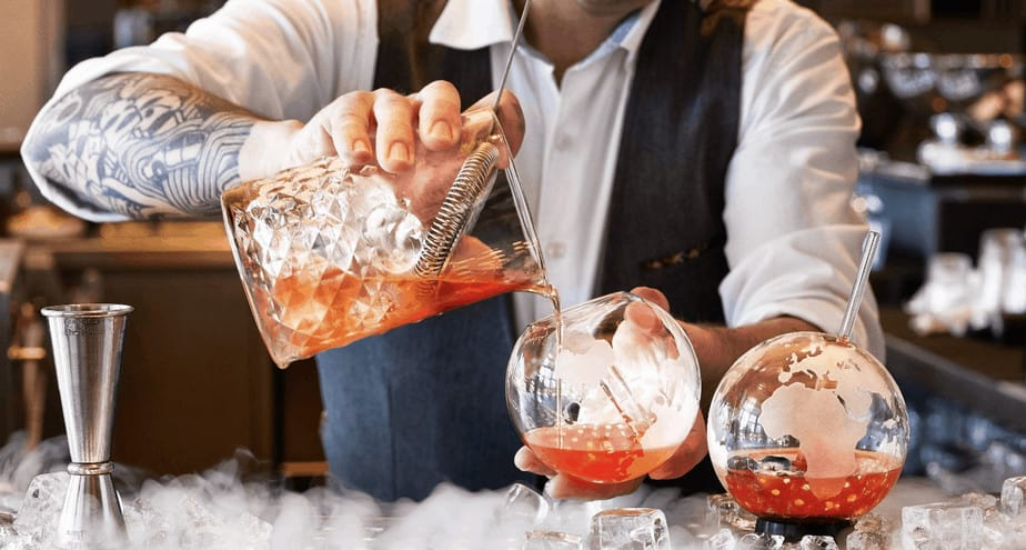 Mixologist in the bar in luxury Barcelona