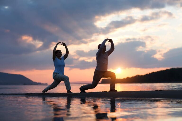 Man,And,Woman,Doing,Tai,Chi,Chuan,At,Sunset,On beach