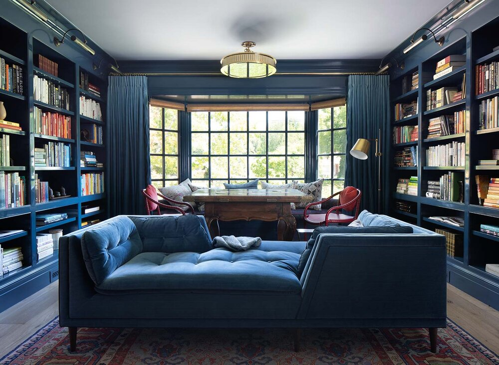 blue library interior design by Annie Lowengart