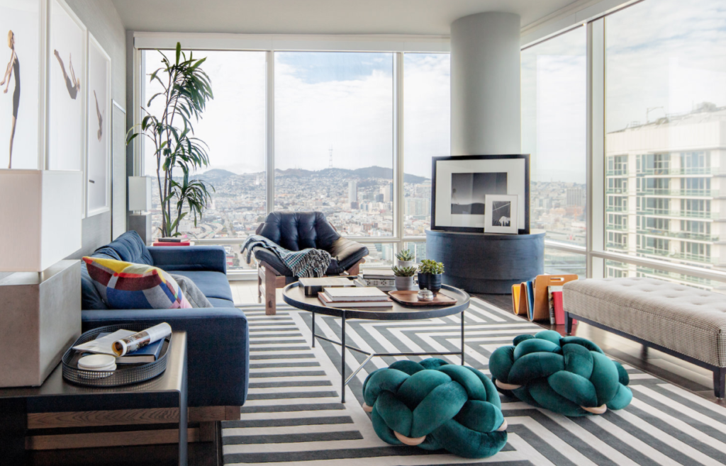 living room design with a view of mountains by top designer emilie munroe