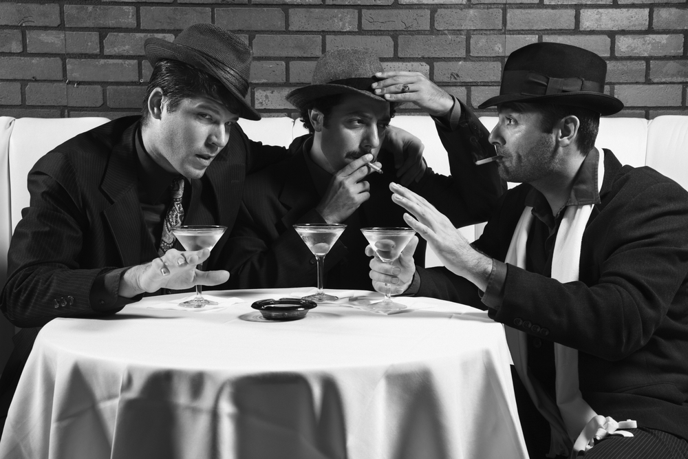 mobsters at a table in a bar