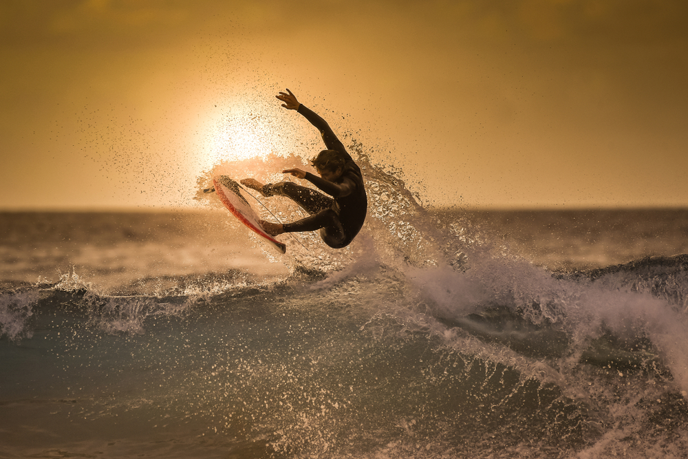 olympic surfer at sunset